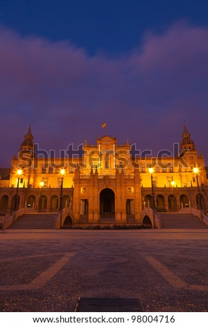 Plaza de Espana in Sevilla at night, Spain. Main building framed by the canal and two bridges. Built in 1928 for the Ibero-American Exposition of 1929