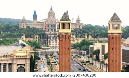 Plaza de Espana, The Venetian Towers and The Palau Nacional in Barcelona, Spain. Cloudy sky, traffic Stock photo ©