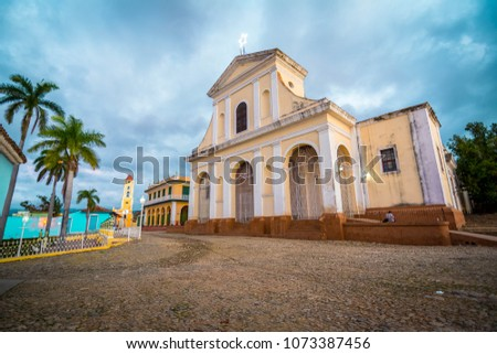 Plaza Mayor is most popular touristic area in Trinidad. Church and synagogue in one square. Tourists are mostly get rest in the park and enjoy the wifi in Trinidad, Cuba. #1073387456