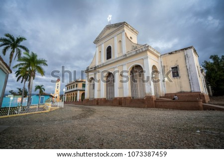 Plaza Mayor is most popular touristic area in Trinidad. Church and synagogue in one square. Tourists are mostly get rest in the park and enjoy the wifi in Trinidad, Cuba. #1073387459