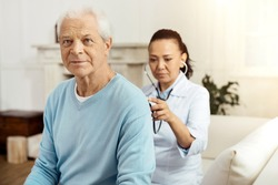 Pleasant elderly man having a medical examination