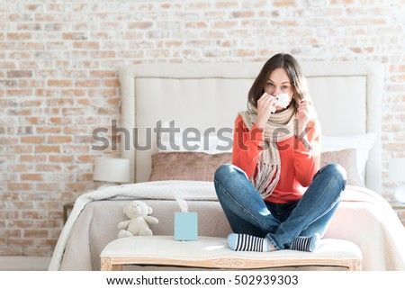 Shutterstock Pleasant gloomy woman suffering from cold