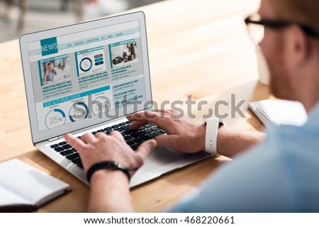 Pleasant man using laptop