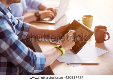 pleasant man using tablet