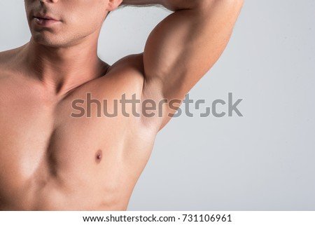 Pleasant nude man is showing his body parts