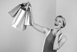 Pleasant shopping. big sale. female shopaholic hold shopping bags. present packages for holiday preparation. summer discount. special offer on black friday. shop closeout. happy woman shopper.