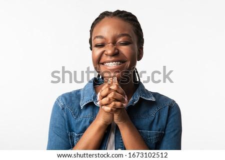 Please. Black Girl Begging Making Pleading Gesture Posing Over White Background. Studio Shot