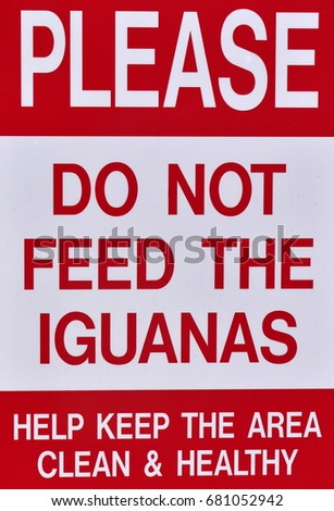 Please do not feed iguanas sign