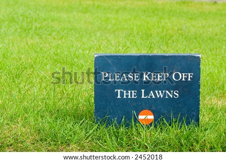 Please keep off the lawns, stone sign in the park