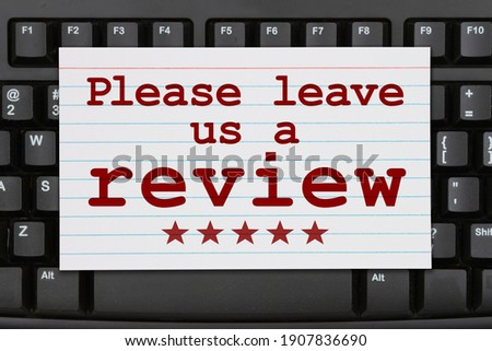 Please leave a review message on a index card on a black keyboard  Stock photo ©