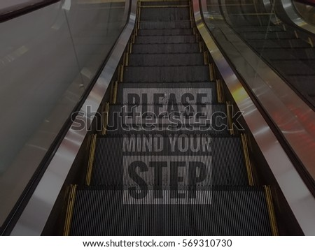 please mind your step words with escalator background