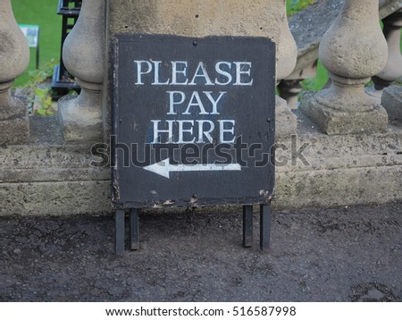 Please pay here sign with direction arrow #516587998