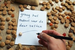 Please put the presents in front of the door written in the Dutch language on a paper between ginger nuts.