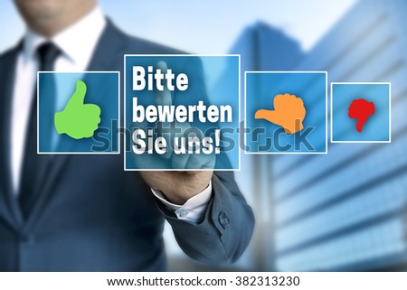 Please rate us (in german language bitte bewerten sie uns) touchscreen is operated by businessman