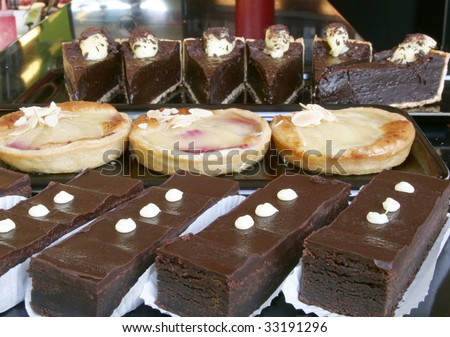 Please see all my other food photos as well. Line up of chocolate slices, tarts and cakes.