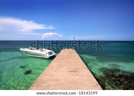 pleasure boat docked - stock photo