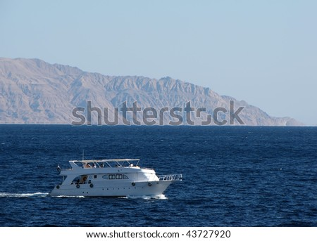 Pleasure boat on the background of the island of Tiran, Red Sea, Egypt