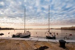 Pleasure boats moor  in harbor with bollard.