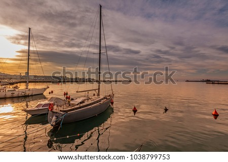 Pleasure boats moored in harbor at sunset. Trieste Italy #1038799753