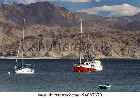 Pleasure boats near southern beach of the Red Sea in Eilat, Israel