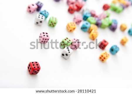 Plenty of dices with a red one in front with six on it. Slightly rotated view.