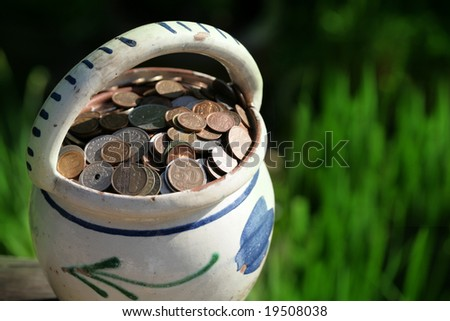 plenty of money coins in flower pot