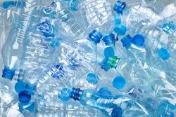 Plenty of plastic bottles on white background top view