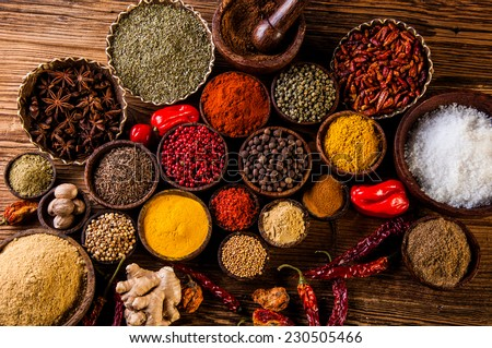 Plenty of traditional Asian spices in wooden bowls #230505466