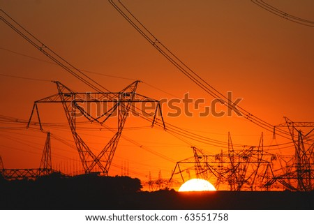 plenty of transmission towers during sunset