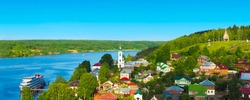 Ples, Russia. Panoramic view from Cathedral Mountain on a cute country town. Small city on the Volga River, ship on the pier, river cruises