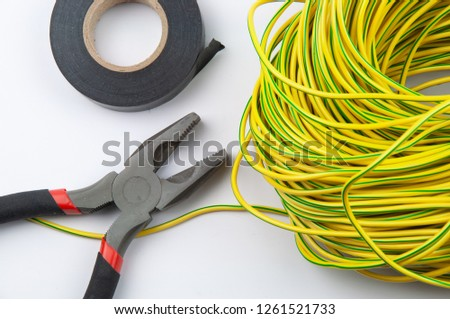 pliers electrical tape and bundle of wires on close-up