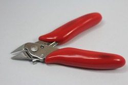 Pliers pliers cut pliers with red plastic handle, white background hardware for construction or daily repair, selective focus
