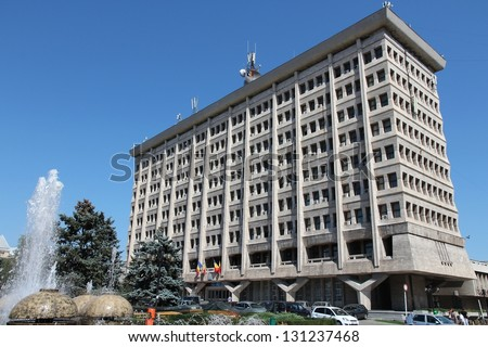 PLOIESTI, ROMANIA - AUGUST 20: People visit City Hall on August 20, 2012 in Ploiesti, Romania. The famous building known as Casa Alba was built in 1968-71 and designed by Sever Nitu.