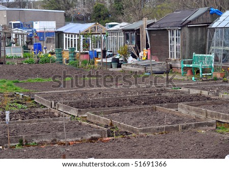 Plots in the allotment, with greenhouses and other buildings