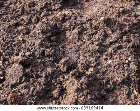 Ploughed farmland with brown loamy soil. #639169414