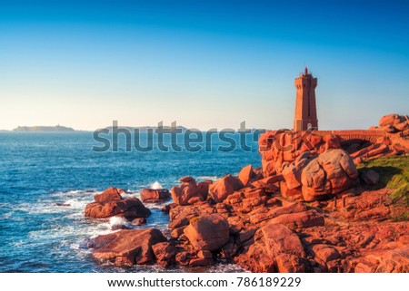 Shutterstock Ploumanach Mean Ruz lighthouse red sunset in pink granite coast, Perros Guirec, Brittany, France
