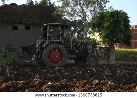Plow is plowing agricultural land #1568738815