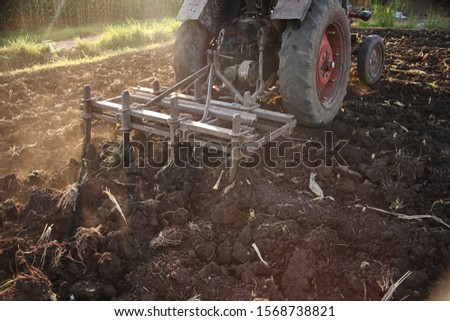 Plow is plowing agricultural land #1568738821