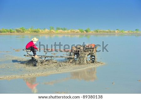 plow man in the rice fields taking a break