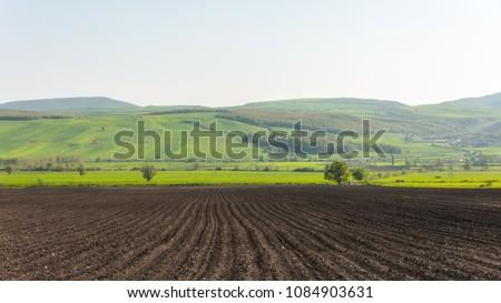 Plowed farmlands, arable fields