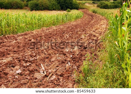 plowed field, ploughed brown earth rural landscape