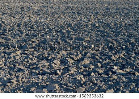 Plowed land. Plowed field background. #1569353632