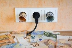 Plug and Euro  money on socket.