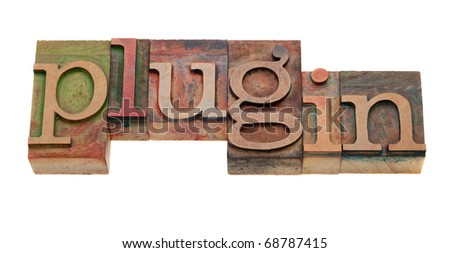 plugin (accessory software or hardware package) - word in vintage wooden letterpress printing blocks, stained by color inks, isolated on white