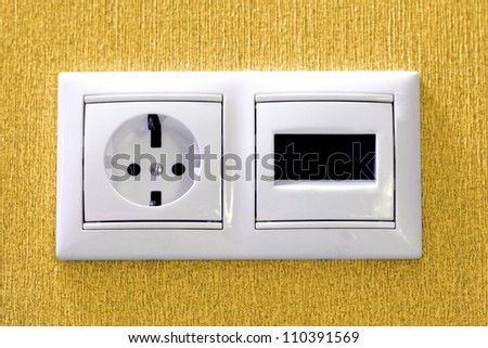 Plugs in electric and phone  socket