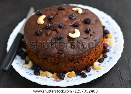Plum cake made with dried fruit, raisins, cashew nuts, almond etc. Tasty home made cake flavored with cinnamon and spices for sale on Christmas and new year Kerala India.