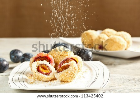 Plum dumplings with buttered breadcrumbs and sugar