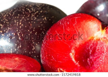 Plum Fruit tree with small juicy edible fruits, which have a large bone,. an oval fleshy fruit that is purple, reddish, or yellow when ripe and contains a flattish pointed pit. #1572419818