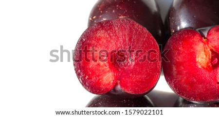 Plum Fruit tree with small juicy edible fruits, which have a large bone,. an oval fleshy fruit that is purple, reddish, or yellow when ripe and contains a flattish pointed pit. #1579022101