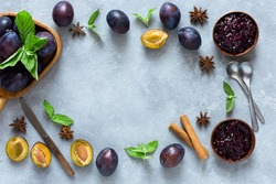 Plum jam and ingredients for its preparation: plums, cinnamon, star anise and mint. Homemade marmalade for a delicious Breakfast. Autumn preparations.